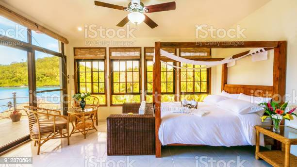 Beautiful tropical resort bedroom interior with comfortable and many picture id912870564?b=1&k=6&m=912870564&s=612x612&h=87tn  zlcp7pcqmalkwkmggsymljyb6mwkjag5bske4=