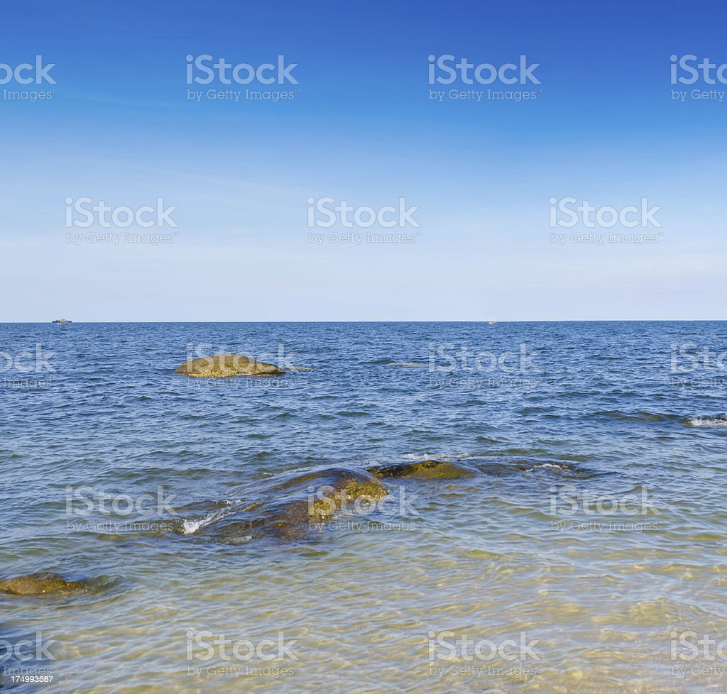Beautiful tropical sand beach against the blue sky royalty-free stock photo