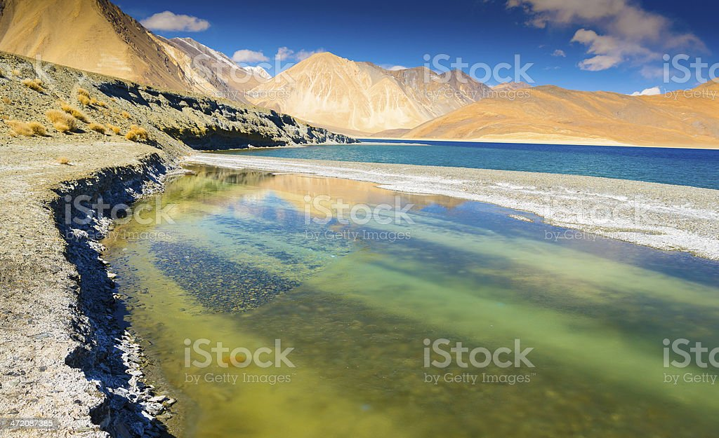 Beautiful tropical sand beach against the blue sky. royalty-free stock photo