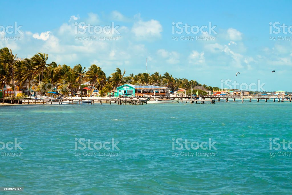 Beautiful tropical shoreline  with piers for boats on the sleepy island of Caye Caulker on the Barrier Reef in the Caribbean Sea stock photo