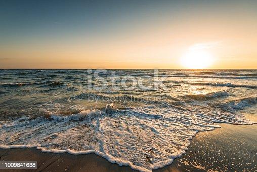 istock Beautiful tropical sunrise on the beach. 1009841638