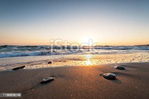 istock Beautiful tropical sunrise on the beach. 1136808246