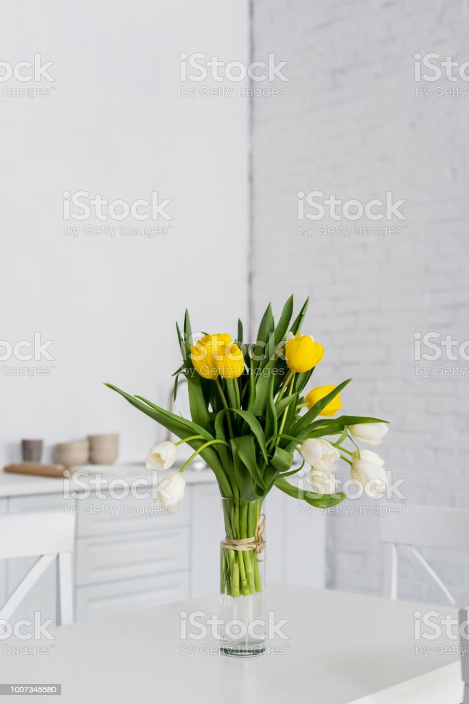 Beautiful Tulip Flowers In Vase On Table At Modern Kitchen Stock