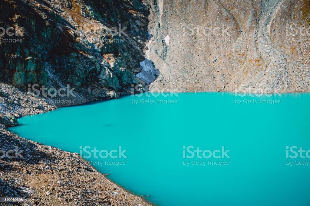 Beautiful turquoise alpine lake in the mountains stock photo