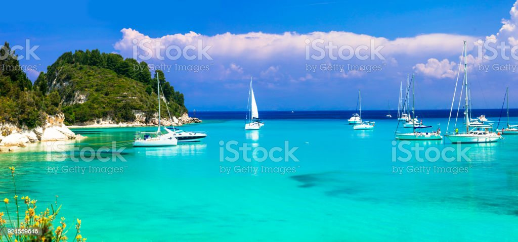 Beautiful turquoise bay Lakka in Paxos with sailing boats. Ionian islands of Greece stock photo