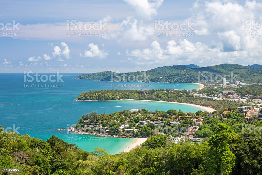 Beautiful turquoise ocean waves with boats and coastline stock photo