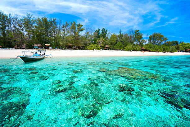Beautiful turquoise sea of Gili Meno, Indonesia Beautiful sea of Gili Meno, with view of Gili Air. Indonesia. indo pacific ocean stock pictures, royalty-free photos & images