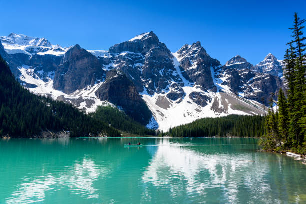 Beautiful turquoise water of the Moraine lake with snow-covered Valley of the Ten Peaks , rocky mountains in Banff National Park of Canada Beautiful turquoise water of the Moraine lake with snow-covered Valley of the Ten Peaks , rocky mountains in Banff National Park of Canada valley of the ten peaks stock pictures, royalty-free photos & images
