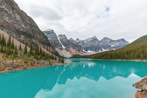 Beautiful turquoise water surround with taiga forest and rocky mountain in summer morning at Moraine Lake, Alberta Canada