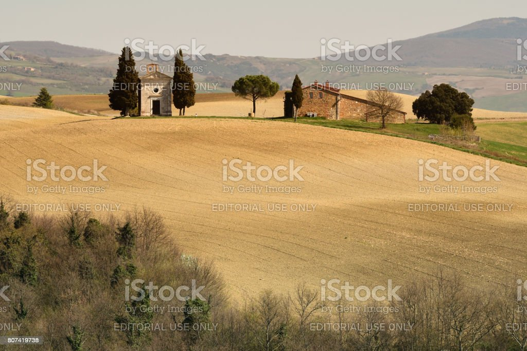 Beautiful Tuscany landscape, little chapel of Madonna di Vitaleta, Pienza, Siena, Italy. stock photo