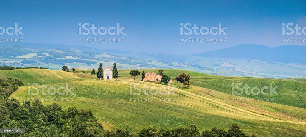 Beautiful Tuscany landscape with famous Cappella della Madonna di Vitaleta in Val d'Orcia, province of Siena, Italy stock photo