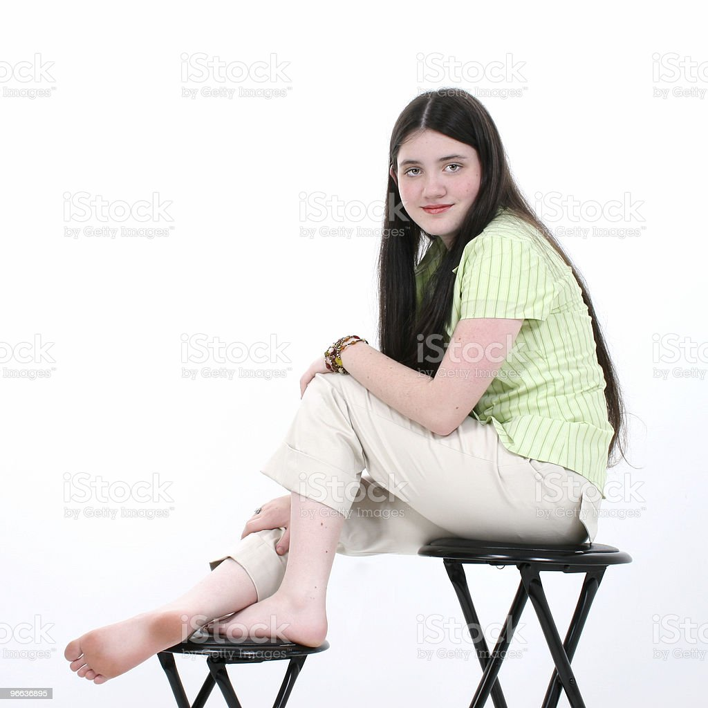 Beautiful Tween Girl Sitting On Stool Stock Photo Download Image Now Istock
