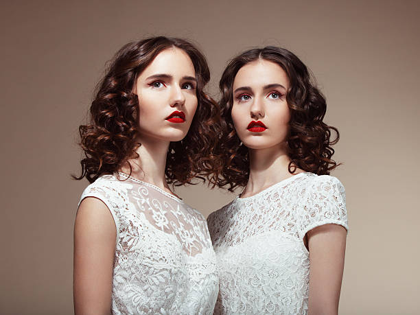 beautiful twins - symmetry stock photos and pictures