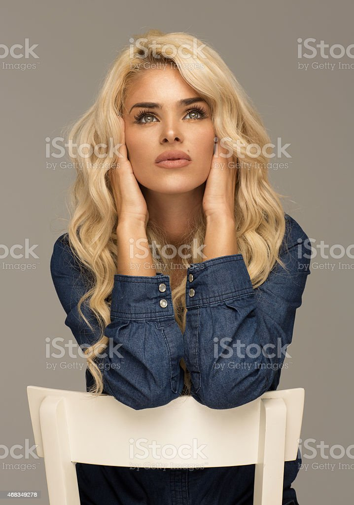 Beautiful unusual blond woman looking up royalty-free stock photo