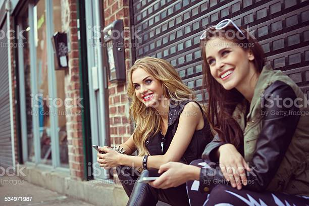Beautiful Urban Girls With Smart Phones Stock Photo - Download Image Now