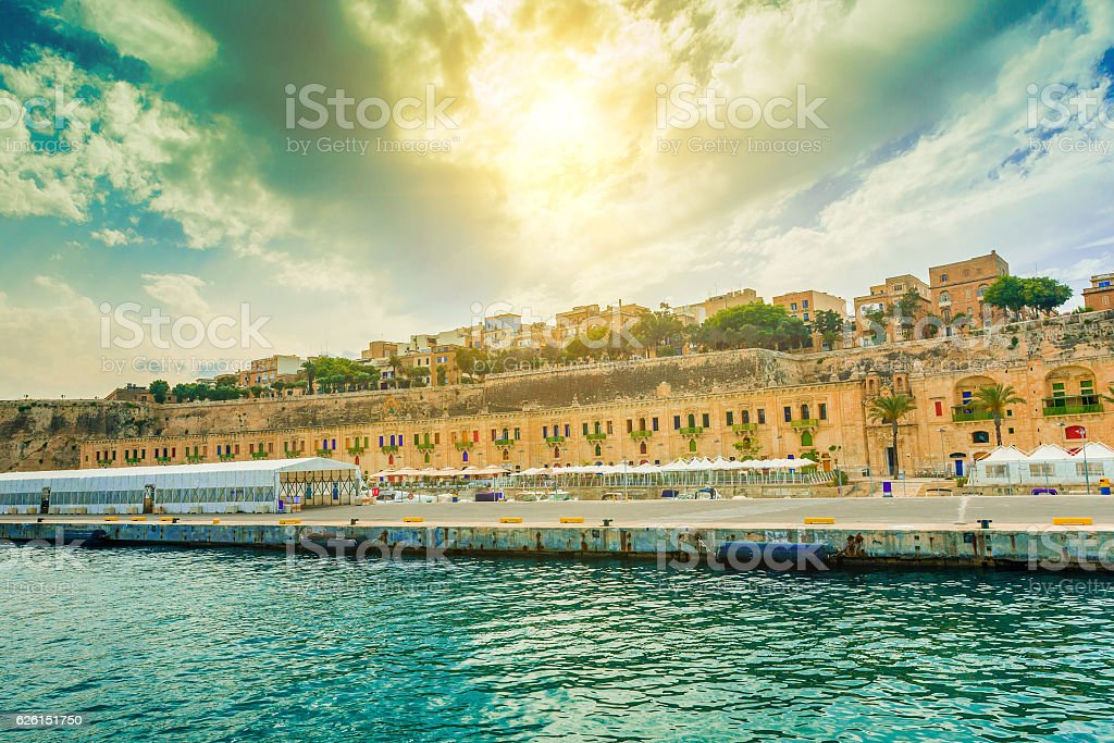 beautiful Valletta embankment street with traditional colorful doors stock photo