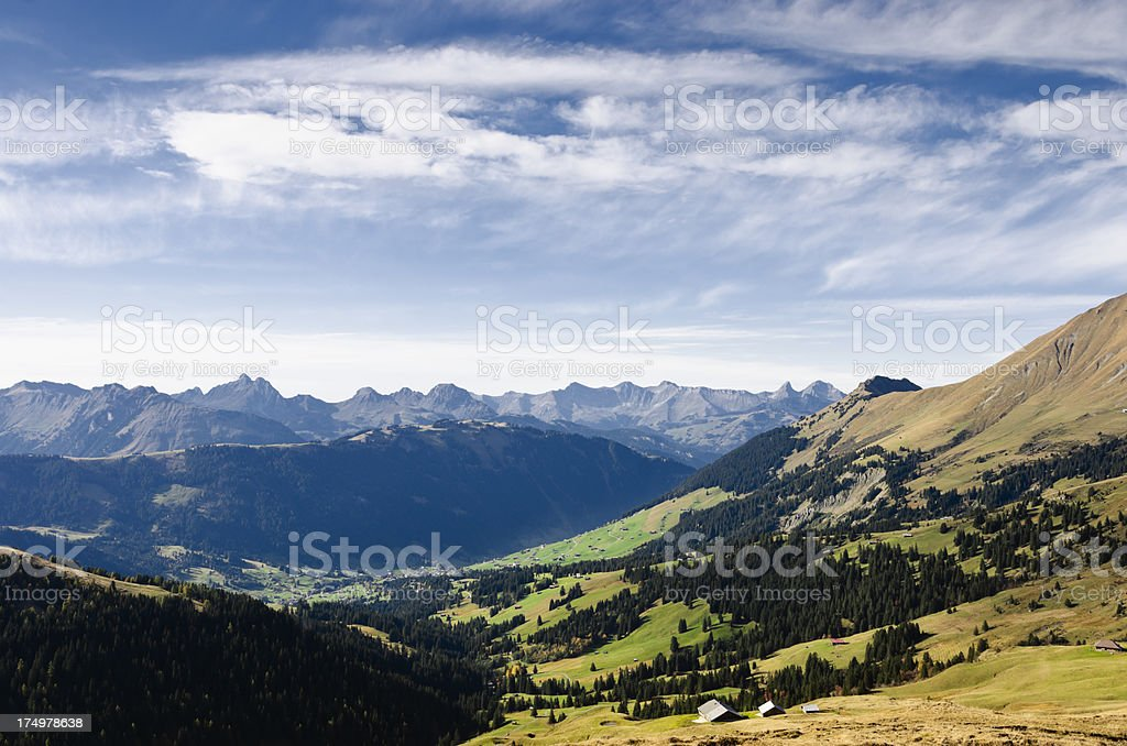 Beautiful valley with a village on Alps in Switzerland royalty-free stock photo