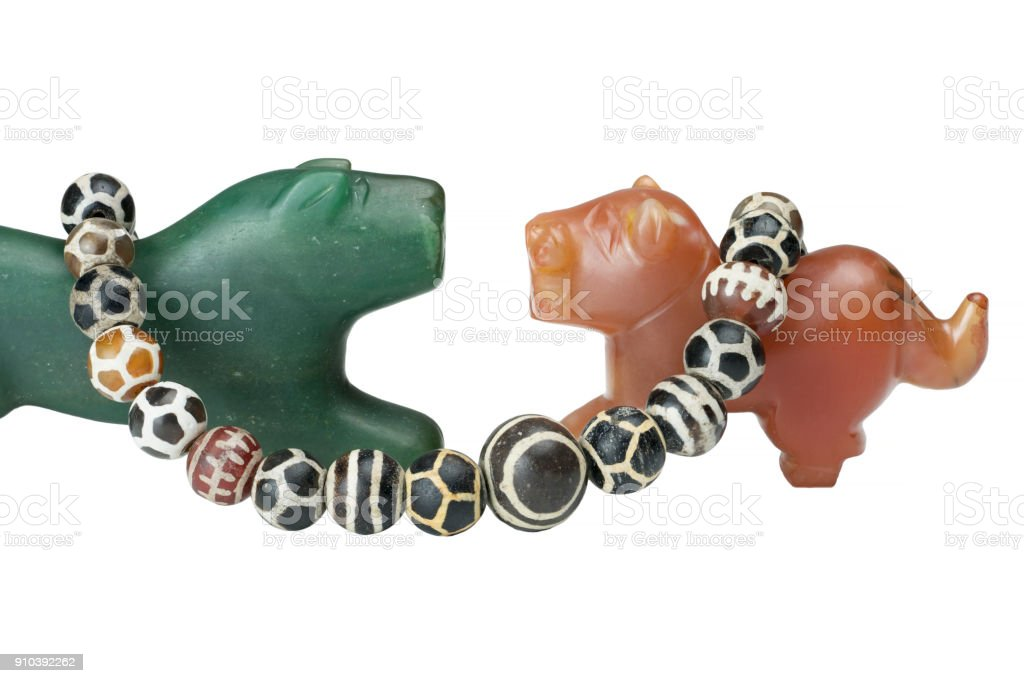 Beautiful valuable Pyu ancient round shaped etched agate and etched carnelian beads in necklace on big Nephrite and Carnelian Pyu tigers ancient beads isolated on white background stock photo