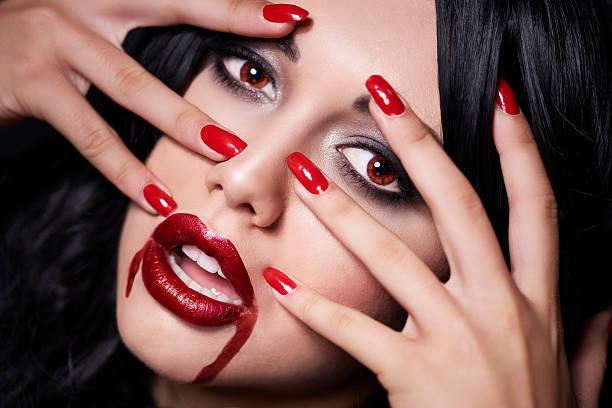 beautiful vampire face with her fingers - vampir schminken frau stock-fotos und bilder