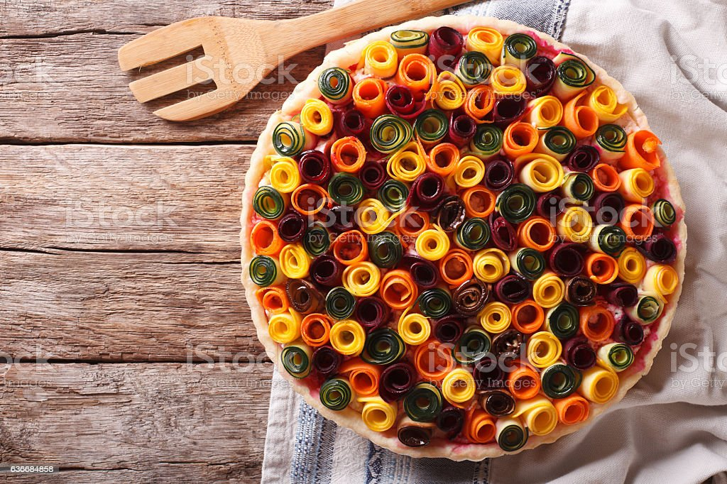 Beautiful vegetable pie with carrots, zucchini, eggplant and beet stock photo