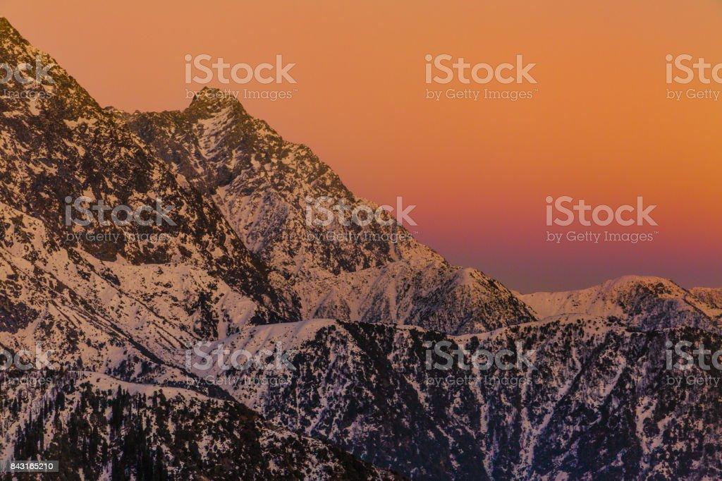 Beautiful, vibrant & colorful Sunset at Triund peak, Mcleodganj, Dharamshala, Himachal pradesh, India. stock photo