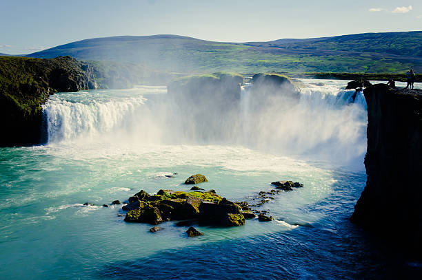 Beautiful vibrant panorama picture with view on waterfall in iceland SONY DSCBeautiful vibrant landscape picture of famous Icelandic Waterfall in Iceland auk stock pictures, royalty-free photos & images