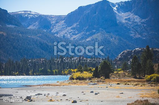 Beautiful vibrant panoramic view of June Lake, Mono County, California, with Mountains of Sierra Nevada and Carson Peak in the background, United States