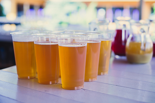 913660988 istock photo Beautiful vibrant picture of gold coloured beer glasses assortment, on wooden table, a summer sunny day, german unfiltered wheat beer 913660978