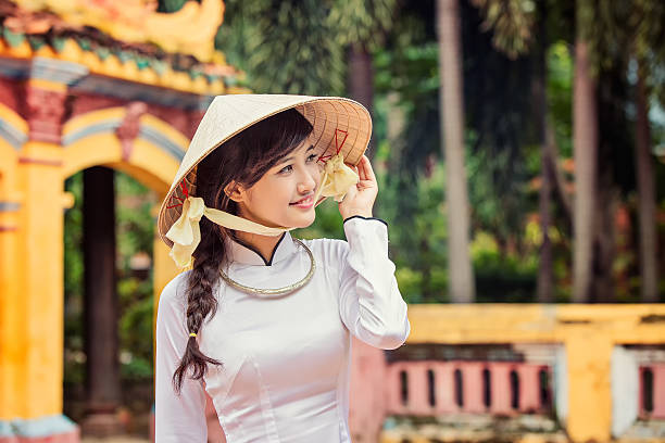 beautiful vietnamese girl in traditional long dress or ao dai - ao dai stock photos and pictures