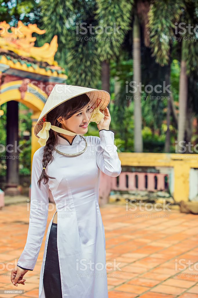 beautiful Vietnamese girl in traditional long dress or Ao Dai stock photo