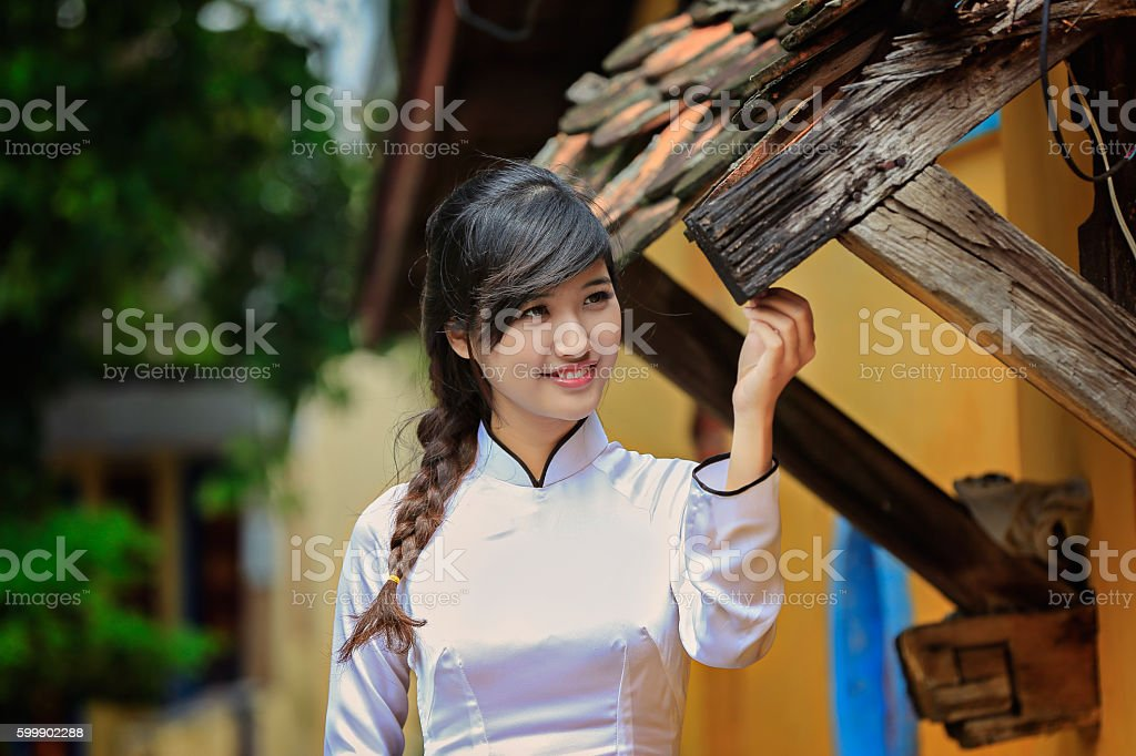 beautiful Vietnamese girl in traditionallong dress or Ao Dai stock photo