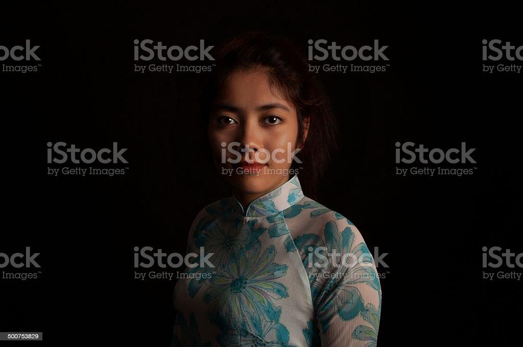 Beautiful Vietnamese girl on black stock photo