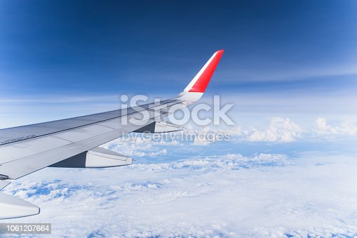istock Beautiful view from airplane window and blue sky on nice sunny day, This time in altitude during flight. 1061207664