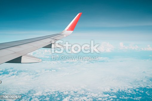istock Beautiful view from airplane window and blue sky on nice sunny day, This time in altitude during flight. 1061207672