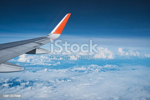 istock Beautiful view from airplane window and blue sky on nice sunny day, This time in altitude during flight. 1061207698