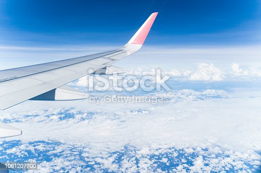 istock Beautiful view from airplane window and blue sky on nice sunny day, This time in altitude during flight. 1061207700