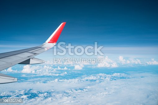 istock Beautiful view from airplane window and blue sky on nice sunny day, This time in altitude during flight. 1061207742