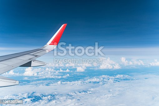 istock Beautiful view from airplane window and blue sky on nice sunny day, This time in altitude during flight. 1061207760