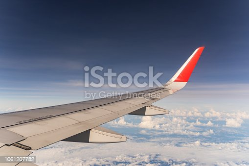 istock Beautiful view from airplane window and blue sky on nice sunny day, This time in altitude during flight. 1061207782