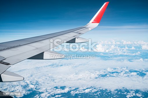 istock Beautiful view from airplane window and blue sky on nice sunny day, This time in altitude during flight. 1061207846