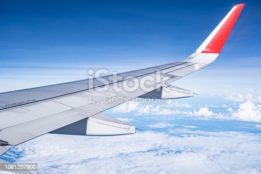 istock Beautiful view from airplane window and blue sky on nice sunny day, This time in altitude during flight. 1061207900