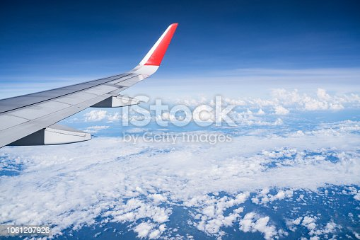 istock Beautiful view from airplane window and blue sky on nice sunny day, This time in altitude during flight. 1061207926