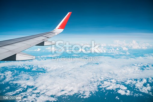 istock Beautiful view from airplane window and blue sky on nice sunny day, This time in altitude during flight. 1061207958