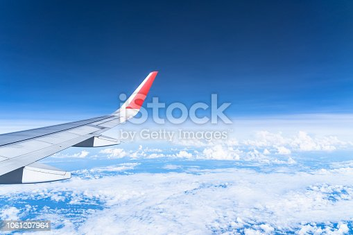 istock Beautiful view from airplane window and blue sky on nice sunny day, This time in altitude during flight. 1061207964