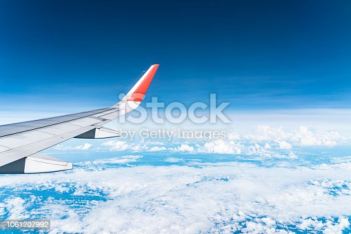 istock Beautiful view from airplane window and blue sky on nice sunny day, This time in altitude during flight. 1061207992