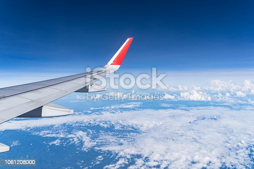 istock Beautiful view from airplane window and blue sky on nice sunny day, This time in altitude during flight. 1061208000