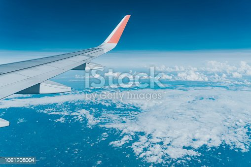 istock Beautiful view from airplane window and blue sky on nice sunny day, This time in altitude during flight. 1061208004