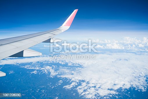 istock Beautiful view from airplane window and blue sky on nice sunny day, This time in altitude during flight. 1061208030