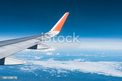 istock Beautiful view from airplane window and blue sky on nice sunny day, This time in altitude during flight. 1061208176