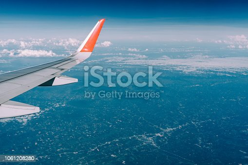istock Beautiful view from airplane window and blue sky on nice sunny day, This time in altitude during flight. 1061208280